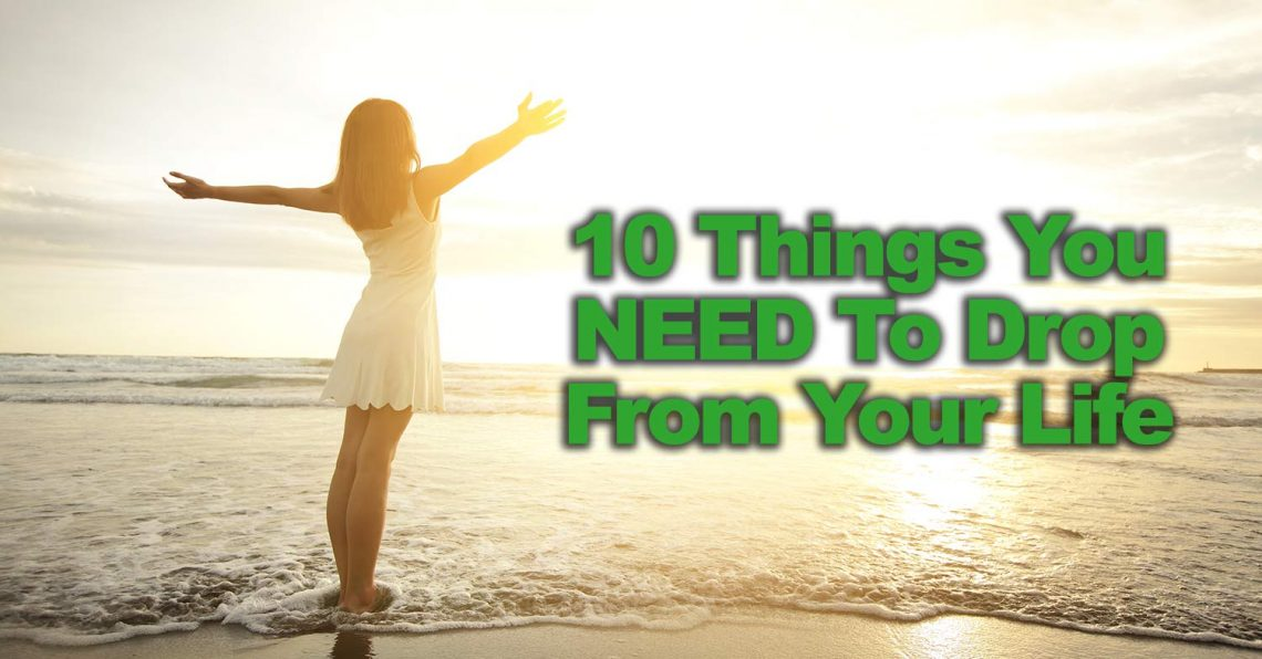 10 things to drop woman standing on a beach with arms raised