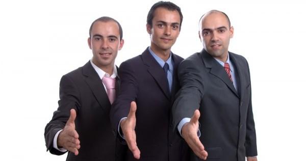 three business men hand shake