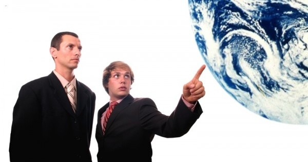 businessman pointing earth
