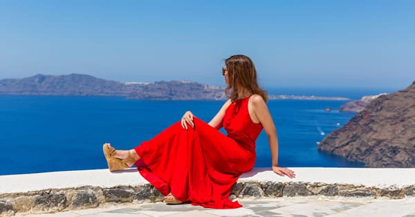 image of woman in red dress blue skies