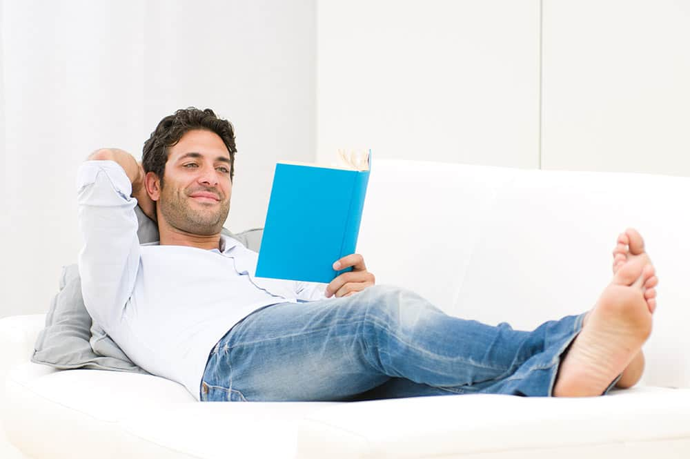 image of single man reading a book