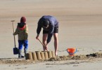 image of child and paretns at beach