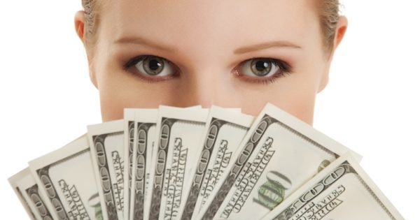 Face of beautiful young woman and the money- doll
