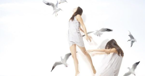 Young girl with seagulls, separation of the soul