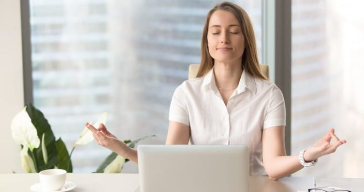 Calm mindful businesswoman practicing breathing, corporate yoga,