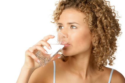 image of young women drinking a glass of water