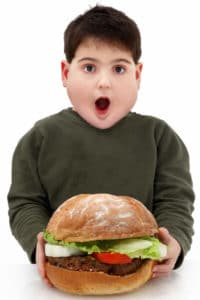 picture of hungry boy with burger