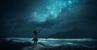 woman looking at the night skies and asking the universe