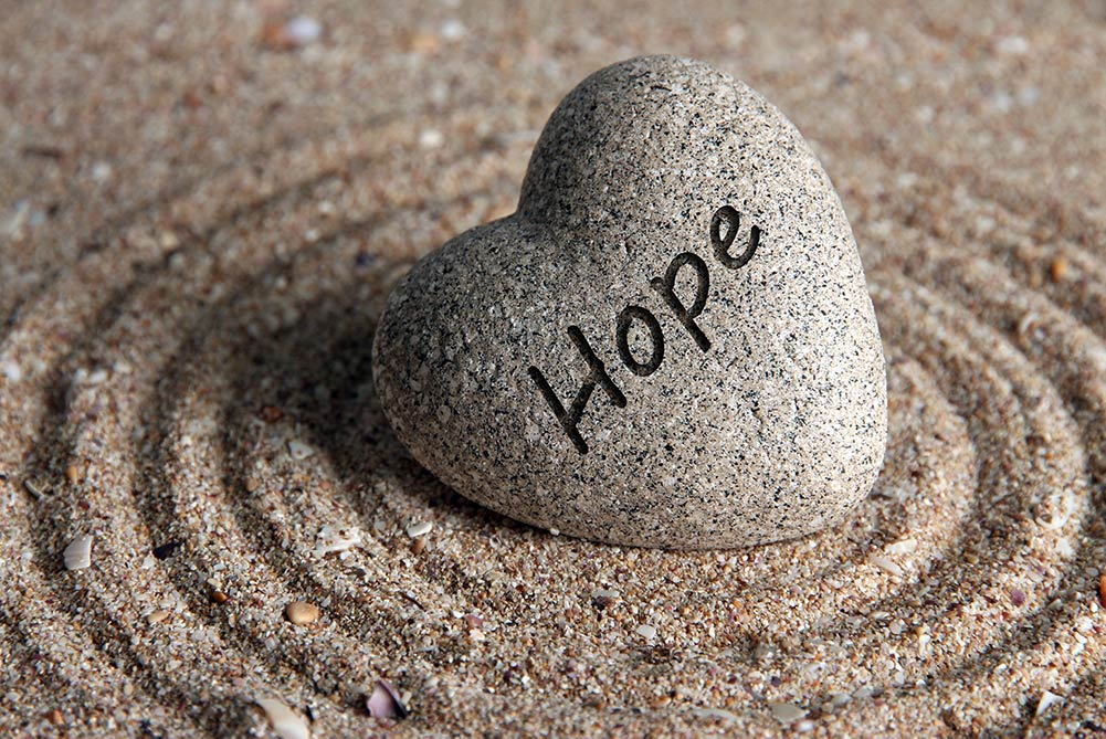 hope stone in the sand