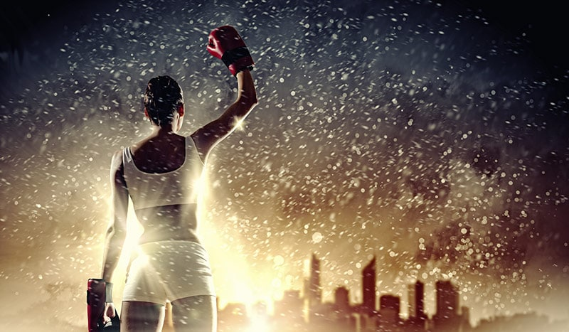 shows an image of a female boxer holding her hand up to the night skies